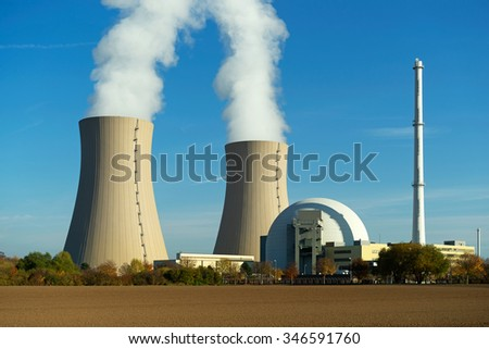 Nuclear power plant on the sky background in the sunlight - stock photo