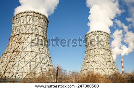 Nuclear power plant smoke  Ecology disaster concept - stock photo