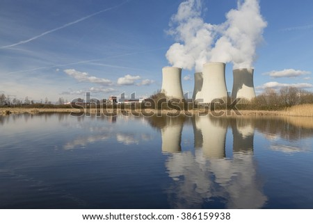 Nuclear power plant Temelin in the Czech Republic reflected in the small lake. - stock photo