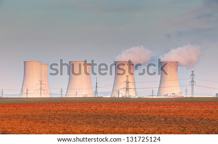 Nuclear power plant with clouds - stock photo