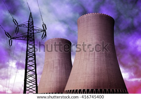 Nuclear power plant with electricity pylon against storm clouds - stock photo