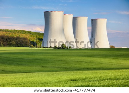 Nuclear power plant with green field.
