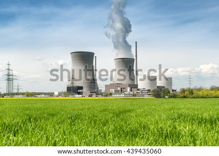 Nuclear power plant with green field and big blue clouds in Germany