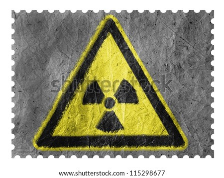 Nuclear radiation sign drawn on paper postage  stamp
