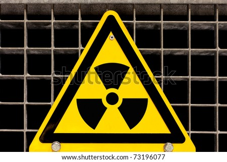 Nuclear radiation warning sign bolted to steel grid