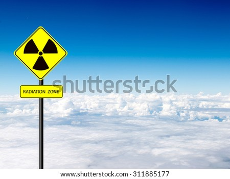 nuclear radiation warning symbol with blue sky