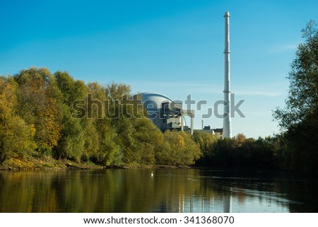 Nuclear reactor  next the pond and its reflection in the water - stock photo