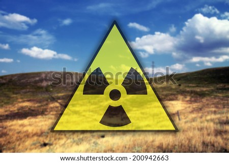 Nuclear sign against landscape background