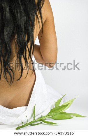 Nude back of woman at spa center massage with bamboo - stock photo