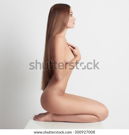 nude beautiful young woman. sexy girl with long hair