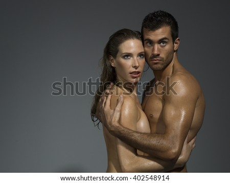 nude couple in love over grey blackground - stock photo
