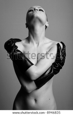 nude elegant girl with the gloves. Studio fashion photo.