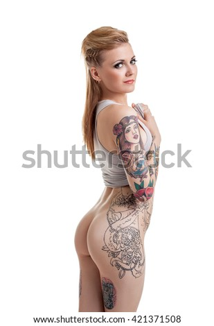Nude. Grinning woman with tattoos on her body