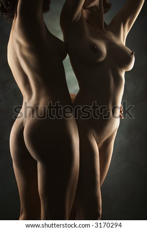 nude women standing together