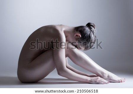 Nude model posing at camera. Concept of inner calm - stock photo