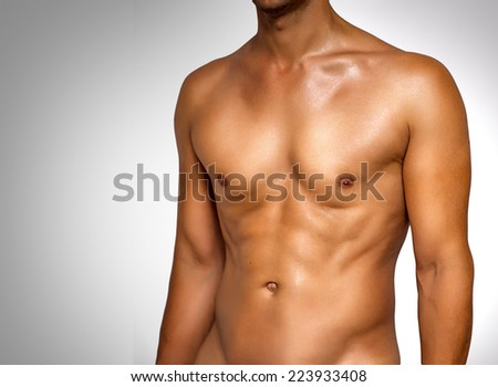 Nude wet muscular torso of unknown man on gray background - stock photo