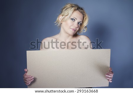 Nude woman holding open hand palm with copy space for product or text - stock photo
