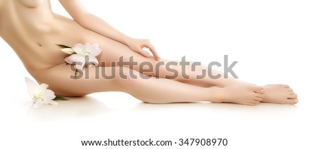 Nude woman, naked girl, concept of body care, spa, massage therapy. Sexy lady, blonde fashion model, Body shape art. Legs, feet, flowers, lily - stock photo