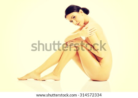 Naked skinny blonde girl with glasses