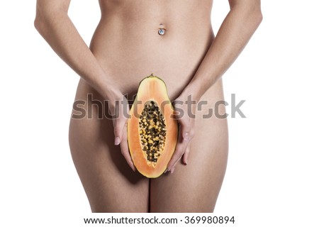 nude woman with a papaya