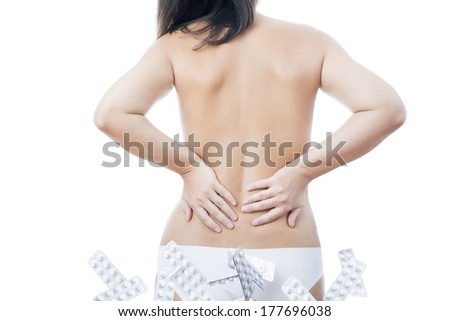 Nude woman with blisters of pills. Isolated on white background.
