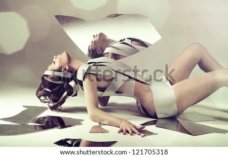 Nude woman with mirror - stock photo