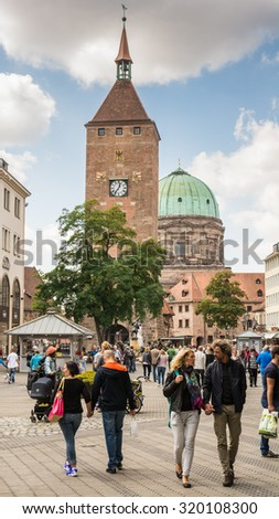 NUERNBERG, GERMANY - SEPTEMBER 5: Tourist at the Weisser Turm tower in Nuernberg, Germany on September 5, 2015. Nuremberg is the second biggest city of Bavaria. - stock photo