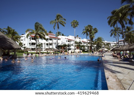 NUEVO VALLARTA, MEXICO - NOV.24, 2015: New Puerto Vallarta is popular  tourists destination. Beautiful beaches and clear warm water of the North Pacific Ocean are attractive to swimmers all year round - stock photo