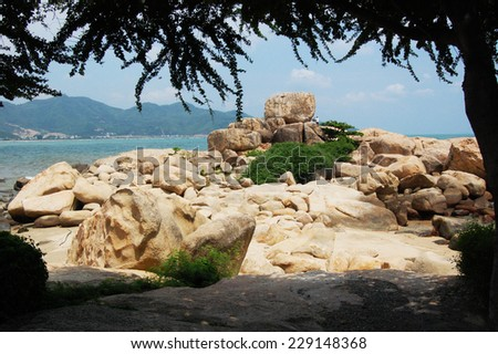 Nui Hon Chong - a cluster of huge stones located on the sea shore in Nha Trang, Vietnam. - stock photo
