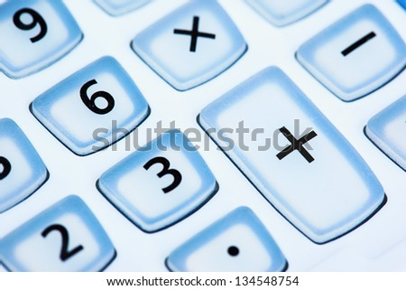 number and  sign on calculator button close up