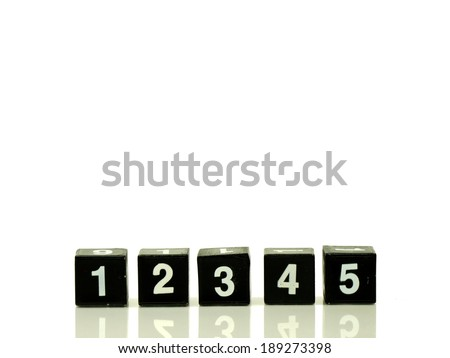 number 1, 2, 3, 4, 5 arranged in line isolated on white background - stock photo