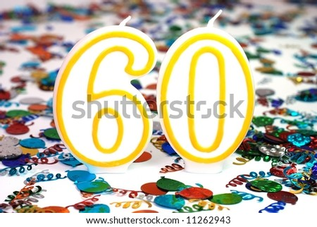 Number 60 celebration candle with confetti.