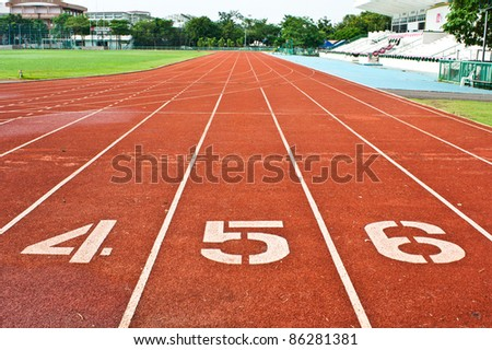 Number four  five and six on the start of a running track - stock photo
