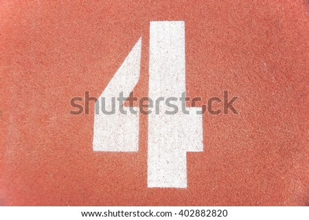 Number four on running race lane