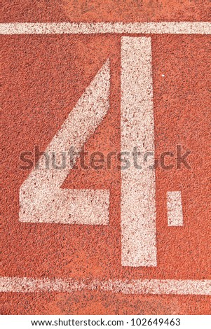Number four on the start of a running track - check my portfolio for other numbers