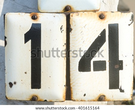 Number fourteen typed on the metal plate - stock photo