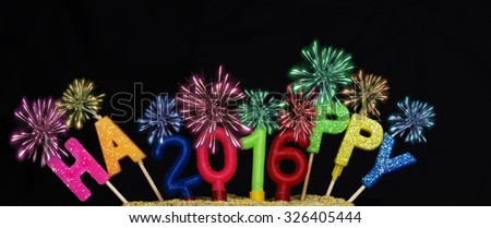 Number 2016 from colorful candles and colorful candles HAPPY on