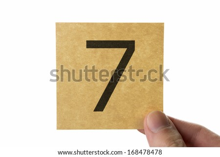 Number 7 icon, brown stick note isolated on white background - stock photo