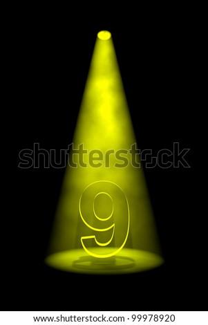 Number 9 illuminated with yellow spotlight on black background - stock photo