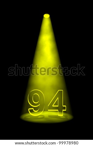 Number 94 illuminated with yellow spotlight on black background - stock photo