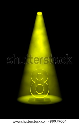 Number 8 illuminated with yellow spotlight on black background - stock photo