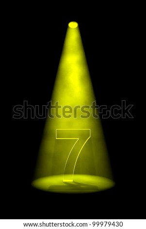 Number 7 illuminated with yellow spotlight on black background - stock photo