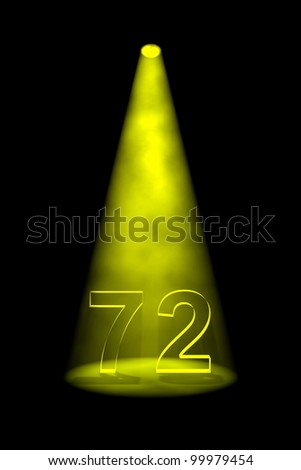 Number 72 illuminated with yellow spotlight on black background - stock photo