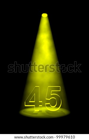 Number 45 illuminated with yellow spotlight on black background - stock photo