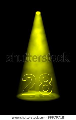 Number 28 illuminated with yellow spotlight on black background - stock photo