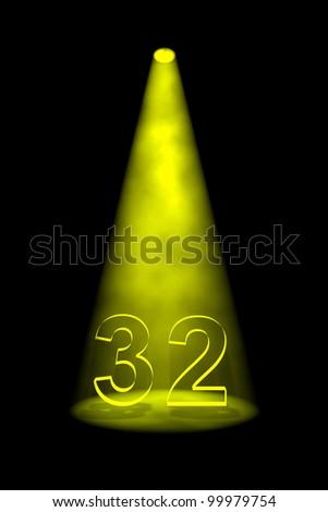 Number 32 illuminated with yellow spotlight on black background - stock photo