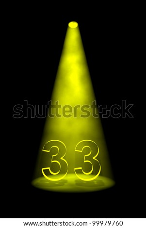 Number 33 illuminated with yellow spotlight on black background - stock photo