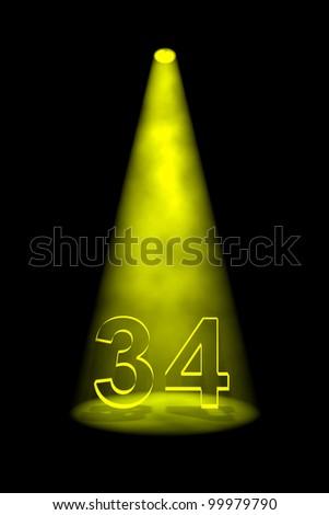 Number 34 illuminated with yellow spotlight on black background - stock photo