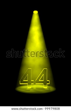 Number 44 illuminated with yellow spotlight on black background - stock photo