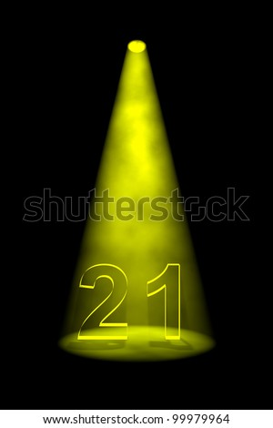 Number 21 illuminated with yellow spotlight on black background - stock photo